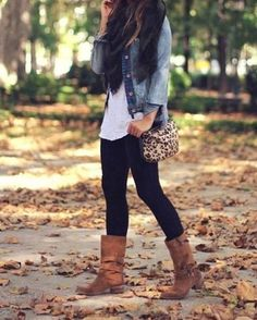White tank, jean jacket, leggings, boots