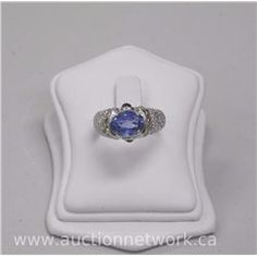 Ladies 18kt White gold Oval Blue Sapphire (2.62ct) and 54 Diamond Custom Made Estate Ring. (14)
