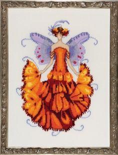 "NC200 - Marigold  Pixie Blossom Collection - Nora Corbett Designs (Mirabilia Designer) Uses / Description: Fabric: 862101  Antique White Jobelan 32ct  Alt Fab: 65110 French Lace Linen 32ct or 355110 French Lace Aida 16ct   Beads: (#of pkgs) 02034 (1), 16026 (1), 40168 (1), 72052 (2)  Kreinik #4 Braid: 9294 (B718 / B1718)   See Nora Corbett Embellishment Pack: NC200E   Approximate Size:  7.25""w x 10""h"