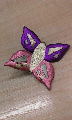 Plastic butterfly brooche