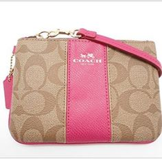 Coach wristlet! Super cute coated canvas wristlet!! Signature style with hot pink accents! Coach Bags Clutches & Wristlets