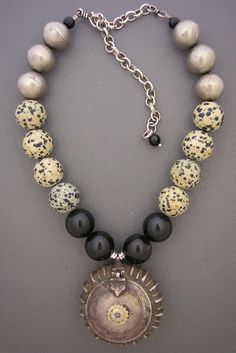 By Anna Holland   An excellent example of an antique (empty) opium case which still opens, probably from India. This case is combined with black onyx beads, jasper polka dot beads, and silver beads on Thai silver  chain. The sterling silver hook and eye clasp was hand-made in Sri Lanka   SOLD