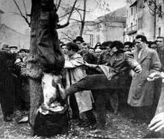 Rebels mutilate the body of an ÁVH member lynched outside the Communist Party Headquarters during the Hungarian Revolution, October 1956 via GK Zhukov& Military History Emporium. Horror Pictures, Horror Pics, Nuremberg Trials, Warsaw Pact, War Image, History Education, First Humans, Budapest, Military History