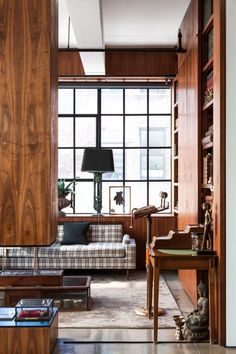 Stepping into this New York City loft apartment directly from the building's lift is like entering the box of a camera, its panoramic exposure taking in the New Yorker hotel and Hudson River.