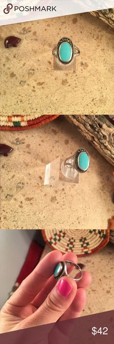 Vintage Navajo Turquoise & Sterling Ring Size 7 Authentic vintage Navajo Sterling silver & Turquoise Ring size 7. This ring is in excellent condition. The ring is 3/4 of an inch long and 1/2 an inch wide. Signed by the artist and stamped Sterling.  Thank you for looking. Please contact me with any questions. Jewelry Rings