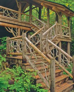 exterior stairs with natural wood handrail and balustrade.