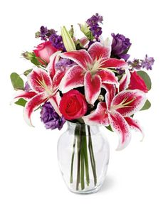 Fancy lilies, roses, and lavender accent flowers combine for the perfect combination in this popular vased bouquet that's just right for almost any expression of love, appreciation, or caring at $59.95  http://www.bboescape.com/products/buy/167/say-it-with-flowers/FTD-Bright-and-Beautiful-Bouquet