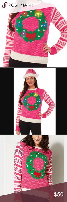 Pink light up holiday sweater Pink Wreath light Up Ugly Christmas Sweater. 100% polyester. Runs on two  AA batteries (not included) Sweaters Cardigans