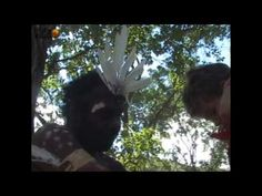 A white child is receiving blessings and protection against diseases from an Australian Aboriginal - the secrets of life.