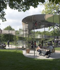 Serpentine | 2009: Kazuyo Sejima & Ryue Nishizawa of SANAA  An abstract steel sunshade, which floats like smoke amidst the trees, was the focus of the Japanese architect's 2009 design, support on slight columns like a parasol on a warm spring day. Photograph © 2009 Edmund Sumner/VIEW