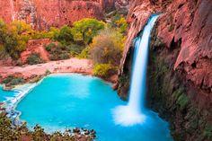 Aqua blue waters tumble from Havasu Falls in the Grand Canyon.