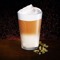 Iced Cardamom Macchiato. A Nespresso recipe 1 caspule Dharkan, ice and shake froth 250ml milk,  mix cardamom syrup with milk in tall glass add froth on top and sprinkle cardamon powder to decorate