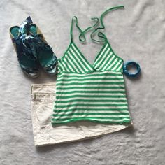 Polo striped halter Polo striped halter Green and white  Size small, short and could be worn as a crop top gently used Please ask for additional pictures, measurements, or ask questions before purchase No trades or other apps. Ships next business day Reasonable offers accepted  Five star rating Bundle for discount Polo by Ralph Lauren Tops