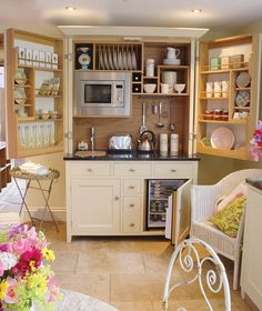A freestanding cupboard with a hidden working kitchen inside! Genius!