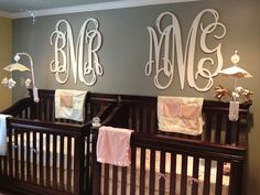 Twin nursery! Madeline and Brayden have their monogram wall art from League of Letters on Etsy.