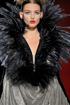 #Feathers Jean Paul Gaultier at Couture Fall 2011 - StyleBistro Amazing black feather collar cape