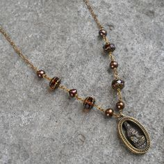 Compassion, Quan Yin genuine freshwater pearls and vintage glass necklace