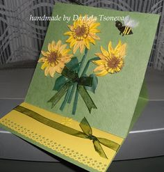 handmade card by Daniela Tsoneva ... bouquet of quilled sunflowers ... easel style ... cute quilled bumble bee ... green base works to unify the papers ... great card!!