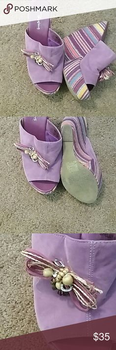 Fun Purple Bow Wedges Really interesting and unique purple suede-like sandals with multi colored platforms in a fun shape with awesome bows. Love them, but they're too small for me. Used. Smoke free. passions Shoes Wedges