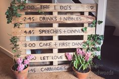 Wooden pallet running order from wedding at Sopley Mill.Photography by one thousand words wedding photographers