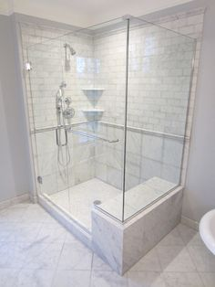 showers with seats | New marble tiled shower with seat.