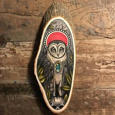 Wood slice with an original drawing of a barn owl