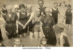 Vintage photo of group of people wading in the ocean - stock photo
