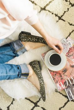Taking a coffee break in leopard print flats.