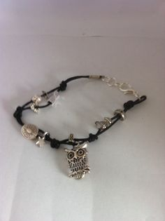 Owl with charms on black cord