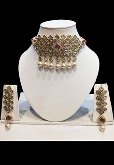 Alloy Based Choker Necklace in White and Pink Allured with Stones and Artificial Pearls Available with a Matching pair of Earrings It is Enclosed with an Adjustable Cord Indian Jewelry, Necklace Set, Chokers, Jewelry Design, Punjabi Wedding, Jewels, Jewellery, Earrings, Cord