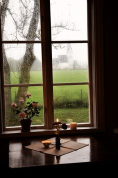 I love the Hygge concept of enjoying the indoors and its comfort on a rainy day This cosy rainy evening, complete with tea and the glow of candlelight Lifestyle Fotografie, I Love Rain, Window View, Through The Window, Rainy Days, Cozy Rainy Day, Windows And Doors, Hygge, Beautiful Places