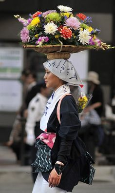 In Kyoto, Japan's old capital, right until the first few years of the last century one sure sign of spring was the Shirakawame, the flower maidens in their special costumes selling flowers on the streets of the city. It is said that the practice started in the Heian period (794-1185) with market ladies delivering flowers to the imperial palace, but by the Edo period (1603-1886) the Shirakawame was almost exlusively young ladies selling flowers in the street. Text and image via Tokyobling