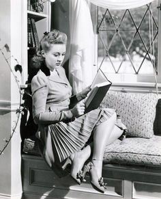 Betty Grable- because only real ladies read in window seats so fabulously ;)