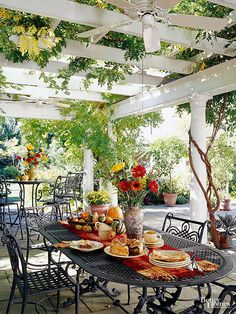 When attached to the house, a dining pergola like this can more easily be fitted with amenities such as wiring for a ceiling fan. This patio is large enough to accommodate more than one dining group as well.