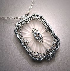 Antique glass art deco pendant - I have one of these in my jewelry - large faceted cut crystal in filigree silver like this - probably came from my grandma