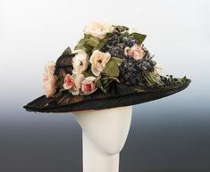Hat | Mme. Pauline  (American) | Date: ca. 1911 | Materials: straw, linen, silk | Oversized hats of the years around 1910 were the perfect stage for opulent display of large and exquisite flowers, and the naturalism and delicacy of the flowers on this elegant hat is particularly notable | The Metropolitan Museum of Art, New York