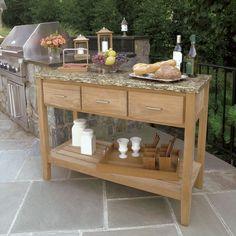 Berwick buffet with Santa Cecilia granite top. Shown with Cucina napkin caddy, nesting tray and Harborside lanterns.