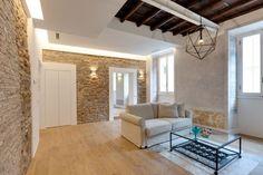 Un apartamento en Roma de estilo moderno y rústico
