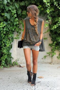 loose french braid side hair with casual sleeveless shirt/muscle tank,  light blue jean shorts, and black gladiator sandals.