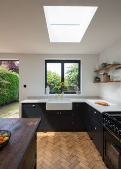 Dark grey Shaker kitchen with a belfast sink and parquet floor. Small Open Plan Kitchens, Grey Shaker Kitchen, Open Plan Kitchen Dining Living, Kitchen Diner Extension, Open Plan Kitchen Diner, Living Room Kitchen, Dark Grey Kitchen, Shaker Style Kitchens, Kitchen Small