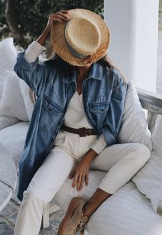 White pants, white long sleeve t shirt, denim jacket, brown belt, hat, casual spring and summer outfit