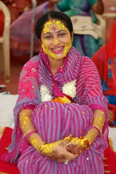 Indian bride-to-be with turmeric on her face and arms