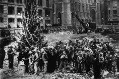 Construction workers line up next to the first #Rockefeller Christmas tree in 1931, waiting to get paid