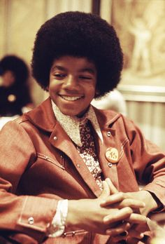 Remembering a shoot with the star at a concert in 1972, when Jackson was just 14, Putland says: 'He was so young, fun and relaxed backstage, and he turned into a human dynamo as soon as his feet touched the stage'