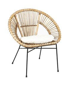 Rattan armchair with cushion. The rattan chair with filiform metal frame for a modern interior or c … by
