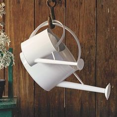 galvanized watering cans #WestElm (with a cool storage idea)