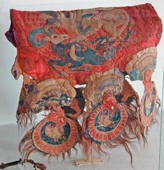 Scythian saddle cover depicting gryphon attacking a mountain goat, 305-288 BCE, excavated 1929. Felt, leather, fur, hair and gold