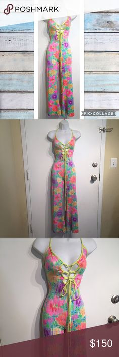 Vintage 60s Colorful Psychedelic Lace Up Jumpsuit True 60s/70s vintage colorful flower child disco hippie jumpsuit Romper. Laces up the front and back and ties around the neck. Size small. Very unique! Definitely a statement piece. Would be awesome for festival season. No modeling. Smoke free home. I do discount bundles. Vintage Pants Jumpsuits & Rompers