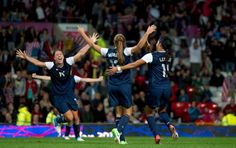 United States' Alex Morgan, center, celebrates with teammates including Abby Wambach, left, and Sydney Leroux after the winning goal was scored past Canada's goalkeeper Erin Mcleod during their semifinal women's soccer match at the 2012 London Summer Olympics, Monday, Aug. 6, 2012, at Old Trafford Stadium in Manchester, England. Photo: Jon Super / AP