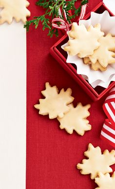 Canada, meet your new favourite cookie. We've done our country's iconic flavour justice by adding maple to the flaky cookie dough, then topping them off with a syrupy glaze. | Image: Canadian Living Holiday Baking 2014 | #Shortbread #HolidayBaking #Christmas #ChristmasCookie #TestedTillPerfect